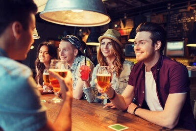 Young adults enjoying beer in a bar